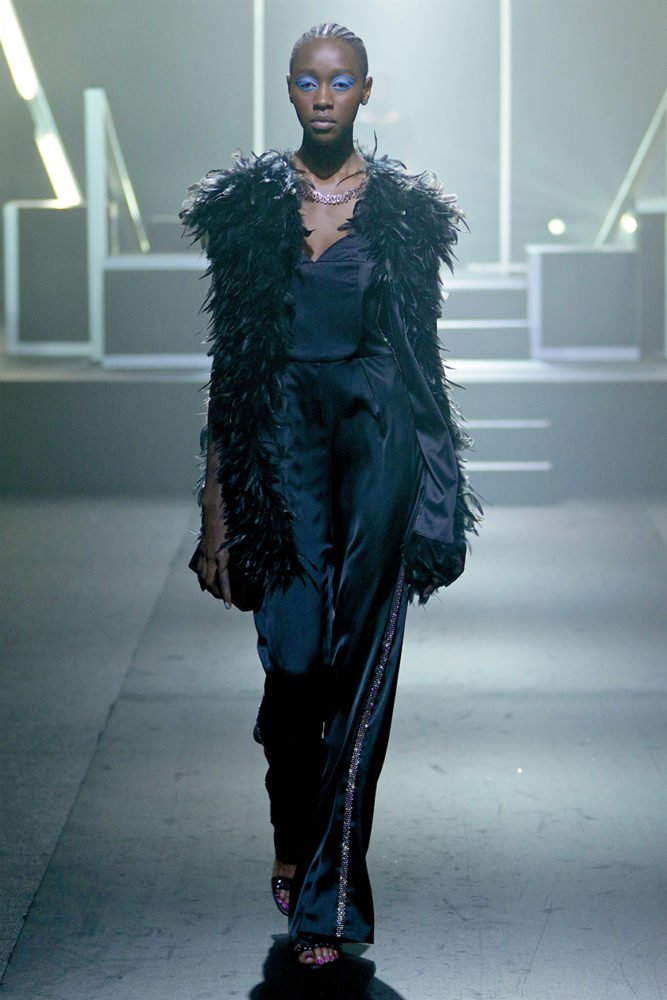 LIEN JUMPSUIT AND FEATHER GILET cover